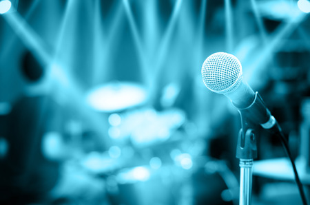 live concert: Close up of microphone on musician blurred background