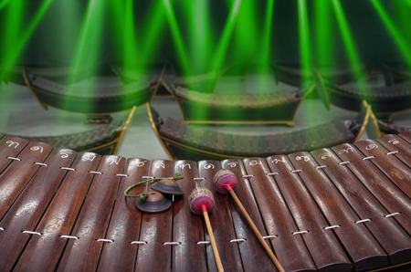 thai musical instrument: Thai musical instrument (Alto xylophone) with note in thai character on blue luminous rays background,asian instrument