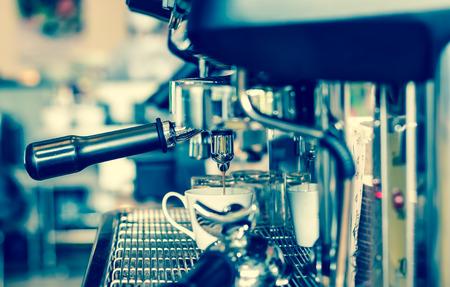 making coffee: Coffee machine making espresso shot in a cafe shop