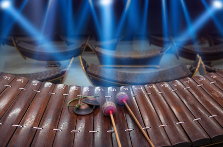 thai musical instrument: Thai musical instrument (Alto xylophone) with note in thai character on blue luminous rays background, Asian instrument