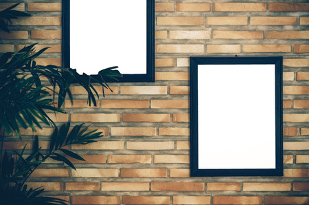 advertise: advertise frame on brick wall background