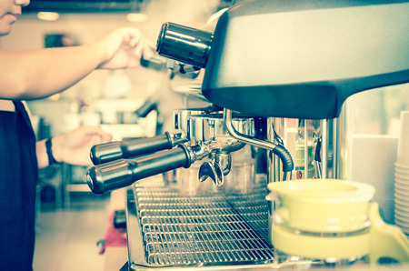 making coffee: Coffee machine making espresso shot by barista in a cafe shop
