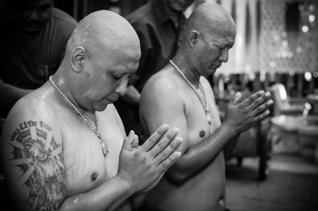 ordination: SAMUTPRAKA, THAILAND - MAY 31: The ordination ceremony, cutting the hair process new priest on May 31, 2015 at phra samut chedi temple in Samutprakan, Thailand, This is Thai Culture for Every Man Becoming a New Monk or Priest.