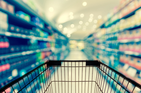 grocery shelves: Abstract blurred photo of store with trolley in department store bokeh background