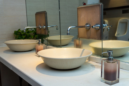 switcher: Chrome faucet with washbasin in modern bathroom
