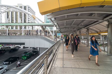 bangkok landmark: BANGKOK - JUNE 25, 2015: Undefined People are walking on the pedestrian bridge which is Bangkok landmark at Chongnonsi SkyBridge at morning for attendance on June 25, 2015 in Bangkok, Thailand.