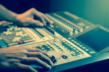 Hand adjusting audio mixer Stock Photo