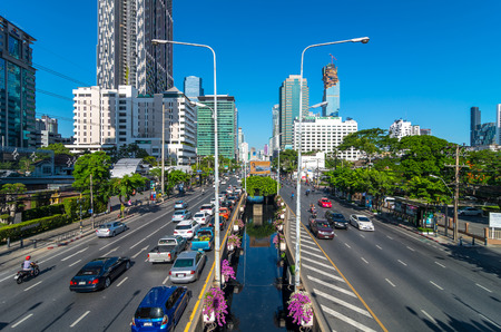 working hour: BANGKOK - JUNE 30, 2015: Traffic on the sathorn road at the morning as working hour on July 30, 2015 in Bangkok, Thailand. sathorn business district is the center of bangkok.