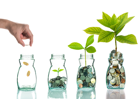 Hand putting mix coins and seed in clear bottle on white background,Business investment growth concept Banco de Imagens - 44462065