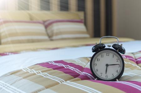 arredamento classico: Retro alarm clock on the bed at morning