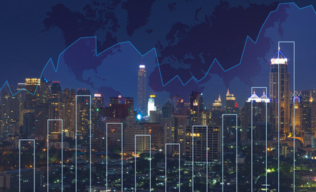Trading graph on the cityscape at night and world map background,Business financial concept Фото со стока - 44798565