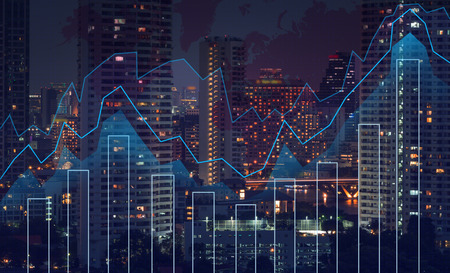 Trading graph on the cityscape at night and world map background,Business financial concept Archivio Fotografico