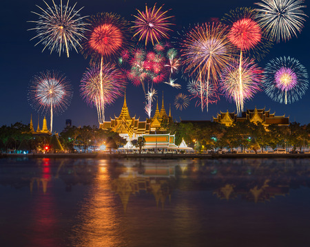 Grand palace river side with Beautiful Fireworks for celebration at twilight time in Bangkok, Thailand