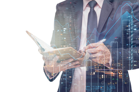 Double exposure of businessman with Trading graph on the cityscape background,Business financial concept Banco de Imagens
