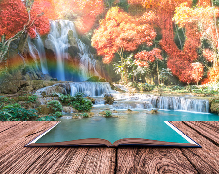 art book: conceptual book image of Beautiful waterfall with soft focus and rainbow in the forest Stock Photo