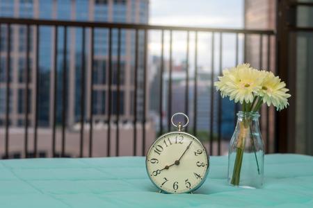 arredamento classico: Retro alarm clock on the bed at morning time