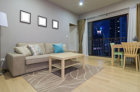APARTMENT LIVING: Luxury Interior living room with blue sky at twilight time Stock Photo