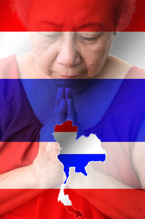 woman praying: Old woman praying with Thailand map and flag background