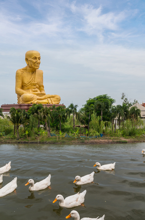 public project: The Big Buddha of Uttayarn Maharach Project with white ducks over the lake, Ayutthaya, Public domain Stock Photo