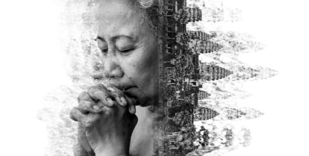 disintegration: Double exposure and Disintegration of old woman praying with Angkor Wat at Siem Reap. Cambodia, black and white tone Stock Photo
