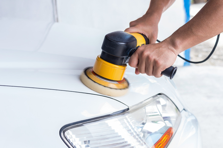 clean car: Polishing the white car, car care concept Stock Photo