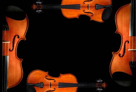 symphony orchestra: Violin orchestra musical instruments on black background