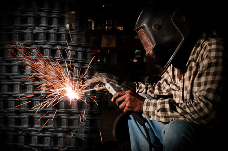 welding mask: welder at work with chain steel