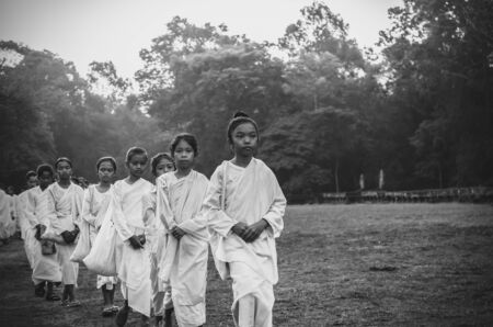 nuns: SIEMREAP, CAMBODIA - MAY 3 : Many unidentified Buddhist nuns girls in white suit walking for celebrate Buddhist Sabbath at Angkor wat at morning on May 3, 2015 in Siem Reap, Cambodia