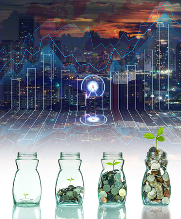 clear bottle: Mix coins and seed in clear bottle with business trading graph background,Business investment growth concept
