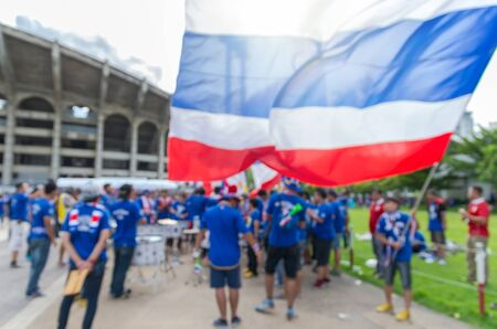 thailand flag: Abstract blurred photo of fan sport with music instrument for cheer and thailand flag at stadium, sport background concept Stock Photo