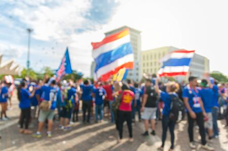 thailand flag: Abstract blurred photo of fan sport with thailand flag at stadium, sport background concept