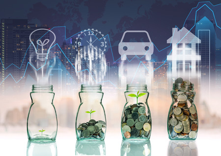 investment ideas: Mix coins and seed in clear bottle on trading graph with cityscape background with sign shape,Business investment growth concept