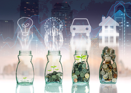 Mix coins and seed in clear bottle on trading graph with cityscape background with sign shape,Business investment growth concept Banco de Imagens - 47493231