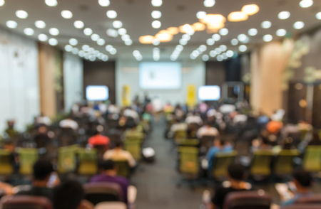 speaking: Abstract blurred photo of conference hall or seminar room with attendee background