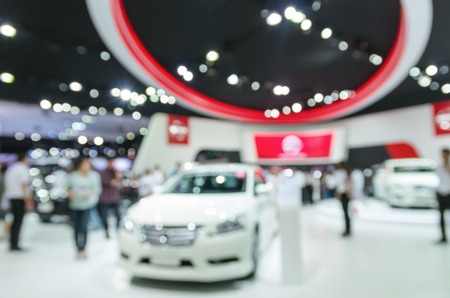color distribution: Abstract blurred photo of motor show, car show room