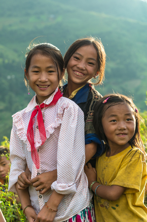 mam: MU CANG CHAI - SEP 25 : Undefined Vietnamese Hmong children smiling in rice terrace on september 25, 2015 at mam xoi of mu cang chai district,Yenbai province, northwest of Vietnam. Editorial