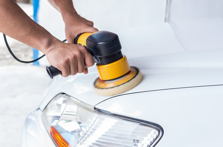 Polishing the white car, car care concept 스톡 콘텐츠