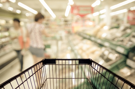 good food: Abstract blurred photo of store with trolley in department store bokeh background