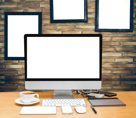 advertise: workspace on brick wall background with advertise frame