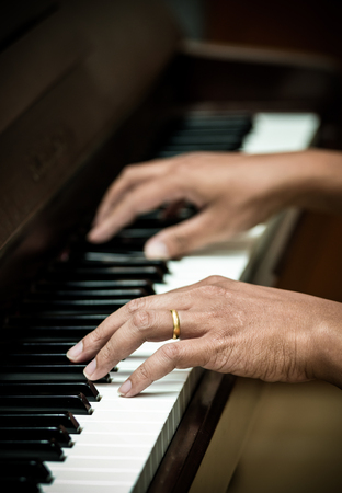 ivories: hands playing the piano,musical instrument Stock Photo