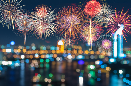 Fantastic festive new years colorful fireworks on cityscape blurred photo bokeh in celebration night