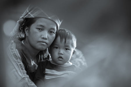 vietnamese ethnicity: MU CANG CHAI - SEP 25 : Undefined Vietnamese Hmong and children in rice terrace on september 25, 2015 at mam xoi of mu cang chai district,Yenbai province, northwest of Vietnam.