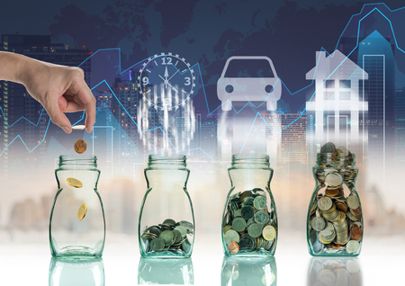 coins: Hand putting mix coins in clear bottle on trading graph with cityscape background with sign shape,Business investment growth concept