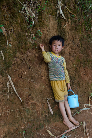 multiple ethnicity: MU CANG CHAI - SEP 25 : Undefined Vietnamese Hmong boy looking at rice terrace on september 27, 2015 at mu cang chai district,Yenbai province, northwest of Vietnam.
