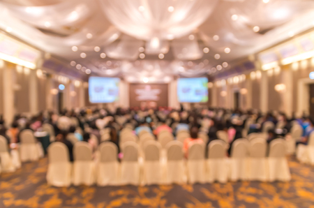 podium: Abstract blurred photo of conference hall or seminar room with attendee background