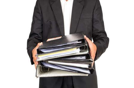 carpeta: El hombre de negocios está llevando a cabo muchas carpetas de documentos, frontal lateral, concepto de negocio ocupado, incluye el camino de recortes Foto de archivo