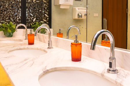 switcher: Luxury Chrome faucet with washbasin in modern toilet