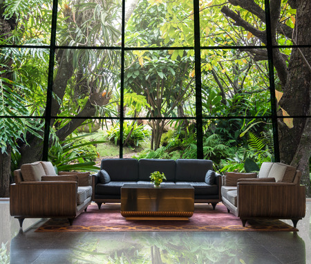 Lobby area of a hotel which can see Beautiful Gardening background