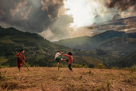 mam: YENBAI - SEP 25 : Undefined Vietnamese Hmong children are playing in rice terrace on september 25, 2015 at mam xoi of mu cang chai district,Yenbai province, northwest of Vietnam.