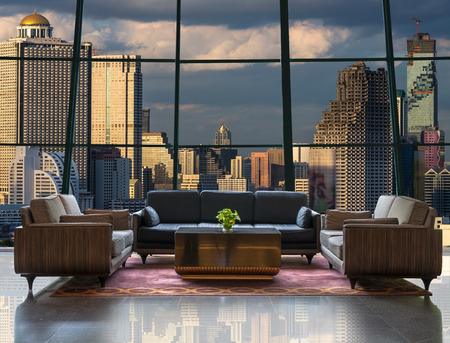 Lobby area of a hotel which can see cityscape at evening time Standard-Bild